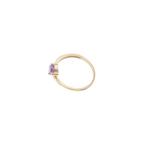 687 - A 9ct gold amethyst and diamond crossover ring. The heart-shape amethysts, with single-cut diamond a...