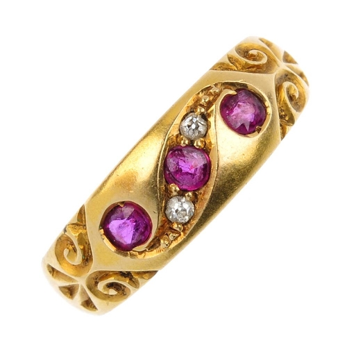 688 - A late Victorian 18ct gold ruby and diamond three-stone ring. The circular-shape ruby line, with old...