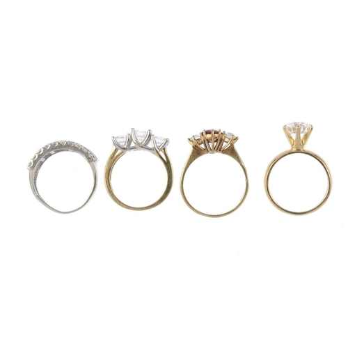 69 - Four gold gem-set rings. To include a 14ct gold cubic zirconia single-stone ring, a 9ct gold garnet ...