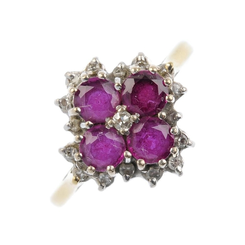 695 - An 18ct gold ruby and diamond cluster ring. The single-cut diamond, with circular-shape ruby quatref...