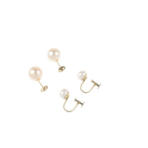 696 - Two pairs of cultured pearl earrings. To include a pair of South Sea cultured pearl ear studs measur...