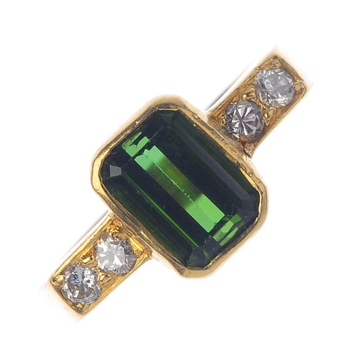 699 - An 18ct gold tourmaline and diamond dress ring. The rectangular-shape green tourmaline, with brillia...