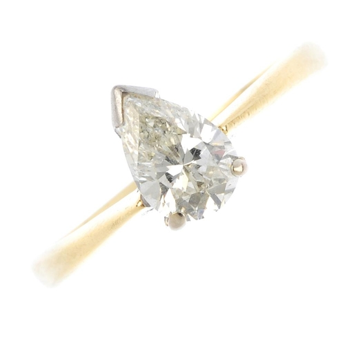 701 - An 18ct gold diamond single-stone ring. The pear-shape diamond, with tapered shoulders. Estimated di...