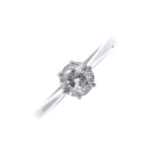 702 - An 18ct gold diamond single-stone ring. The brilliant-cut diamond, with tapered band. Estimated diam...