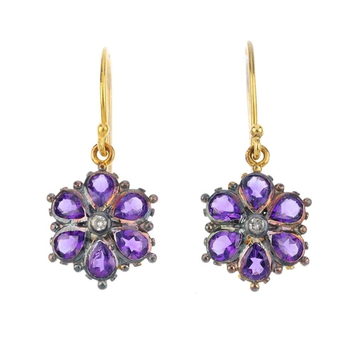 704 - A pair of amethyst and diamond floral earrings. Each designed as a single or brilliant-cut diamond, ...
