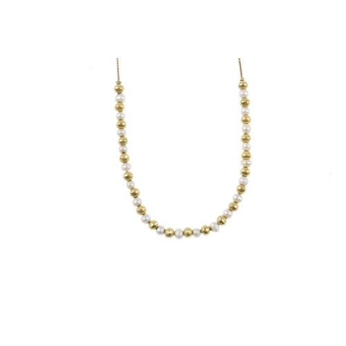 705 - A set of cultured pearl jewellery. The necklace comprising alternating cultured pearls and textured ...