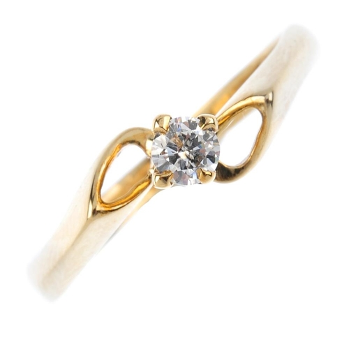 706 - A 9ct gold diamond single-stone ring. The brilliant-cut diamond, with tapered hoop asymmetric should...
