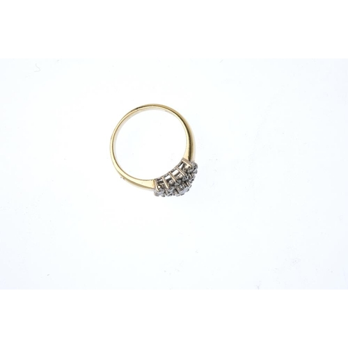 707 - An 18ct gold diamond cluster ring. The brilliant-cut diamond stepped cluster, to the plain band. Tot...