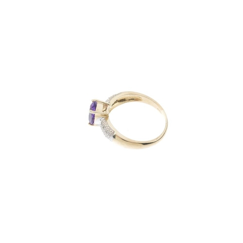 708 - A 9ct gold amethyst and diamond dress ring. The oval-shape amethyst, with illusion-set single-cut di...