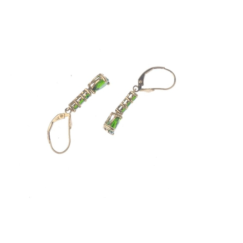 71 - A 9ct gold chrome diopside and diamond pendant, and a pair earrings. The pendant designed as an oval...