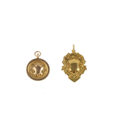 710 - Three 1920s 9ct gold medallions. To include a circular-shape medallion, with central shield-shape va...