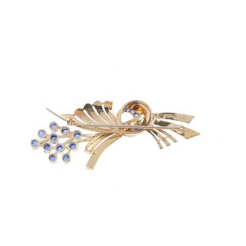 711 - A 1960s 9ct gold sapphire spray brooch. The sapphire cabochon cluster, to the sapphire crescent and ...