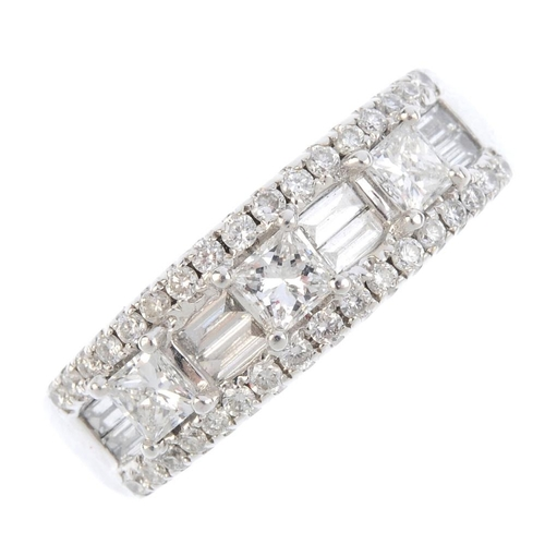 714 - A diamond dress ring. The alternating square-shape and twin baguette-cut diamond line, with brillian...