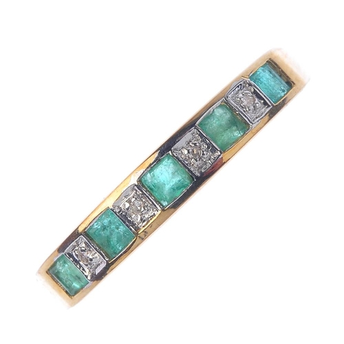 715 - A 9ct gold emerald and diamond half-circle eternity ring. Designed as a square-shape emerald and sin...