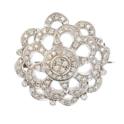 719 - A 9ct gold diamond brooch. The pave-set diamond disc, with brilliant-cut diamond collet and openwork...