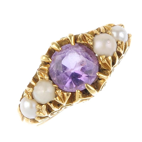 722 - An Edwardian 18ct gold amethyst and cultured pearl dress ring. The circular-shape amethyst and cultu...