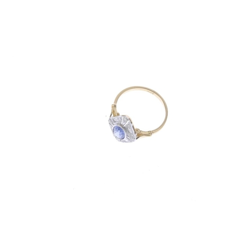 723 - A sapphire and diamond dress ring. Of marquise-shape outline, the oval-shape sapphire, within a sing...