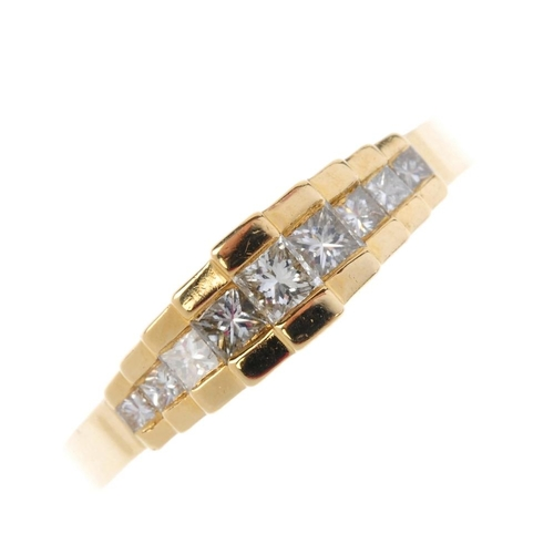 726 - An 18ct gold diamond ring. The square-shape diamond stepped line, with plain sides and tapered band....