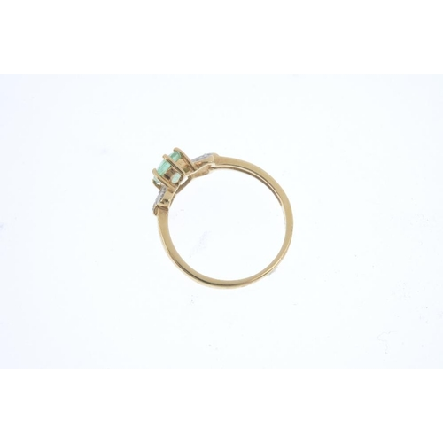 728 - An 18ct gold beryl single-stone ring. The oval-shape green beryl, with single-cut diamond foliate si...