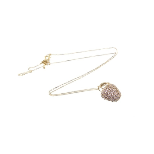 729 - A 9ct gold gem-set pendant and chain. Designed as an apple, the pendant, set throughout with circula...