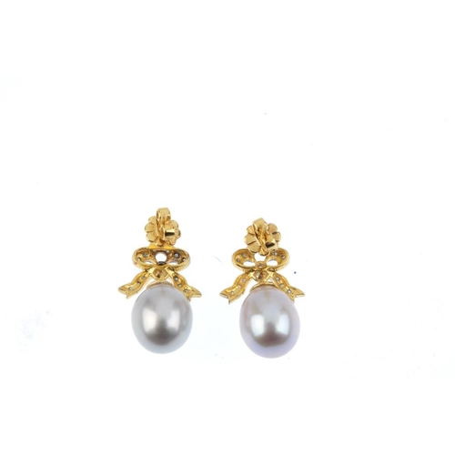 730 - A pair of cultured pearl and diamond earrings. Each designed as a cultured pearl, suspended from a b...