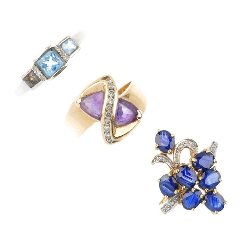 737 - Three diamond and gem-set rings. To include a blue topaz and diamond spacer ring, a sapphire and dia...