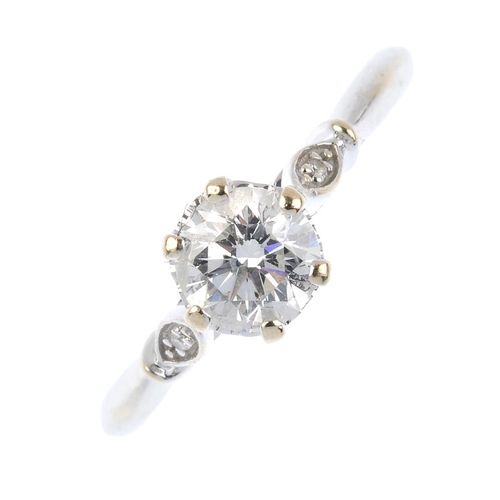 738 - An 18ct gold diamond single-stone ring. The brilliant-cut diamond, with similarly-cut diamond foliat...