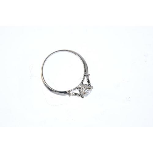 738 - An 18ct gold diamond single-stone ring. The brilliant-cut diamond, with similarly-cut diamond foliat...