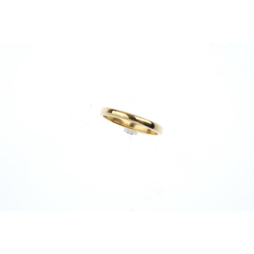 740 - An 18ct gold diamond single-stone ring. The brilliant-cut diamond, with tapered shoulders. Diamond w...