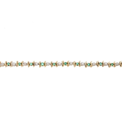 741 - An emerald and diamond bracelet. Designed as a series of circular-shape emeralds, with curved line s...