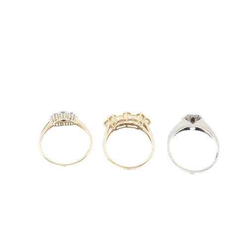 746 - Three diamond and gem-set rings. To include a 9ct gold sapphire and diamond cluster ring, a 9ct gold...