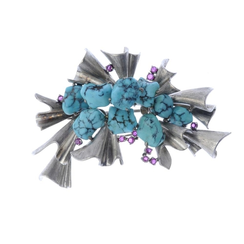 748 - A mid 20th century turquoise and ruby spray brooch. Designed as a series of free form turquoise, wit...