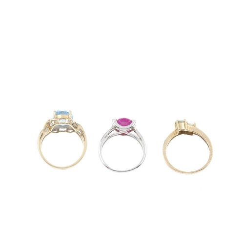 750 - Three 9ct gold diamond and gem-set rings. To include a glass-filled ruby and diamond ring, a green-g...