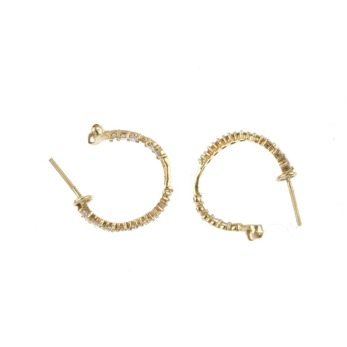 754 - A pair of diamond hoop earrings. Each designed as a brilliant-cut diamond curved hoop. AF. Estimated...