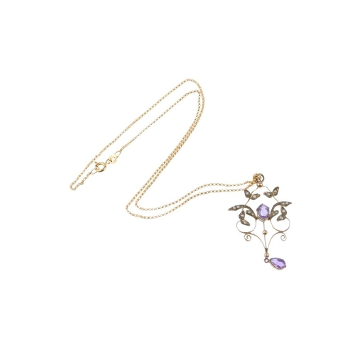 756 - A 9ct gold Edwardian amethyst and split-pearl pendant. Designed as an oval-shape amethyst, with spli...