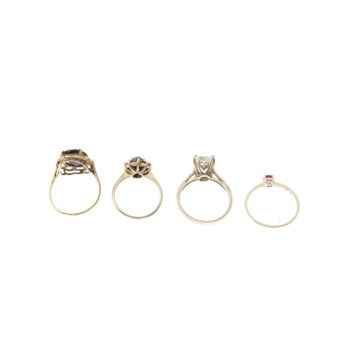 757 - Four 9ct gold gem-set rings. To include a glass-filled ruby single-stone ring, a sapphire, ruby and ...