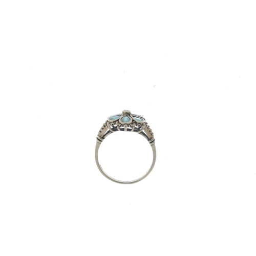 758 - A 9ct gold diamond and emerald cluster ring. The old-cut diamond collet, with pear-shape emerald sur...