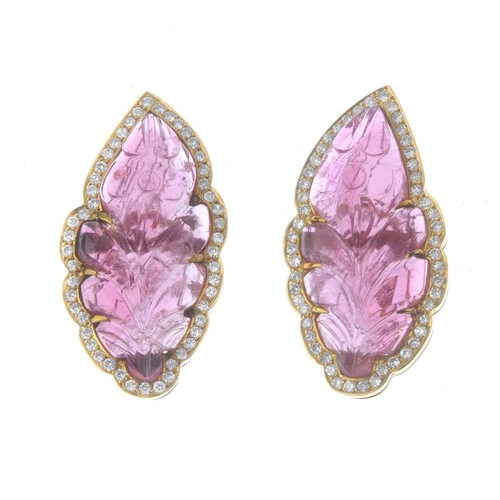 762 - A pair of tourmaline and diamond earrings. Each designed as a carved pink tourmaline leaf, with bril...
