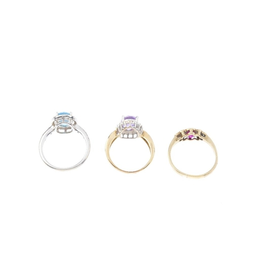 765 - Three diamond and gem-set rings. To include a 9ct gold blue topaz and diamond dress ring, a 9ct gold...