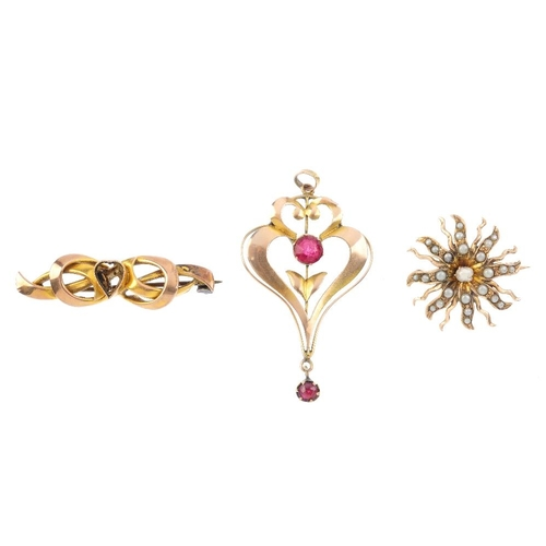 766 - Three early 20th century 9ct gold items of jewellery. To include a split pearl star brooch, a red pa...