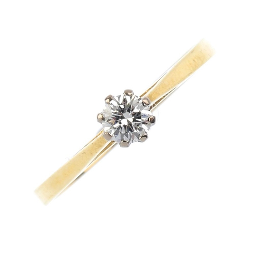 767 - An 18ct gold diamond single-stone ring. The brilliant-cut diamond, with tapered shoulders and plain ...