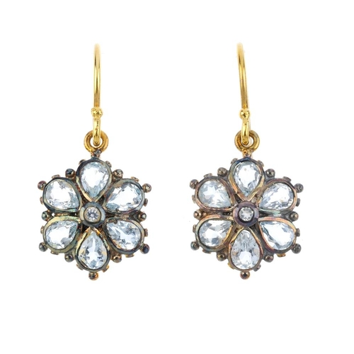 768 - A pair of topaz and cubic zirconia floral earrings. Each designed as a circular-shape cubic zirconia...