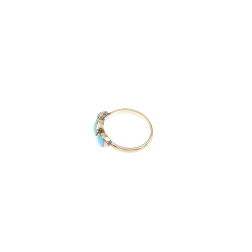 769 - A turquoise and paste three-stone ring. The circular-shape turquoise and paste cabochon graduated li...
