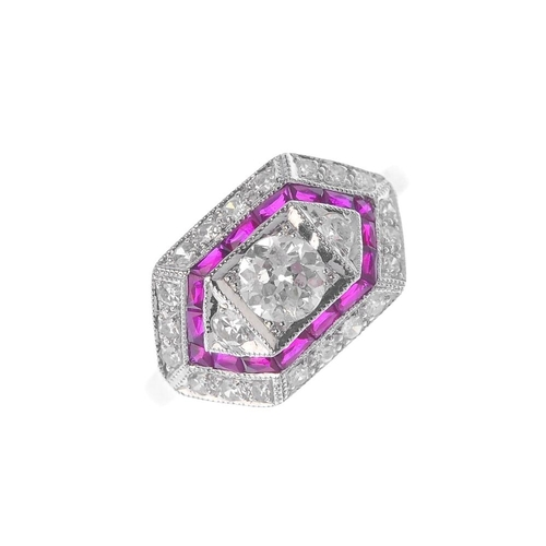 77 - A diamond and ruby dress ring. Of lozenge-shape outline, the circular and single-cut diamond line, w...