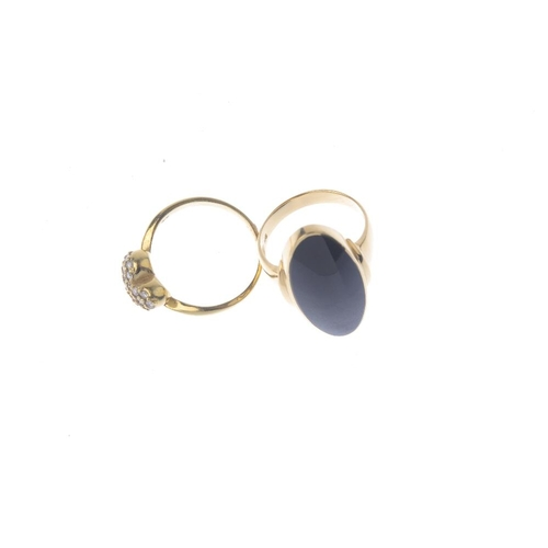 770 - A diamond ring and an onyx ring. The first deigned as a diamond pave-set heart, the second designed ...