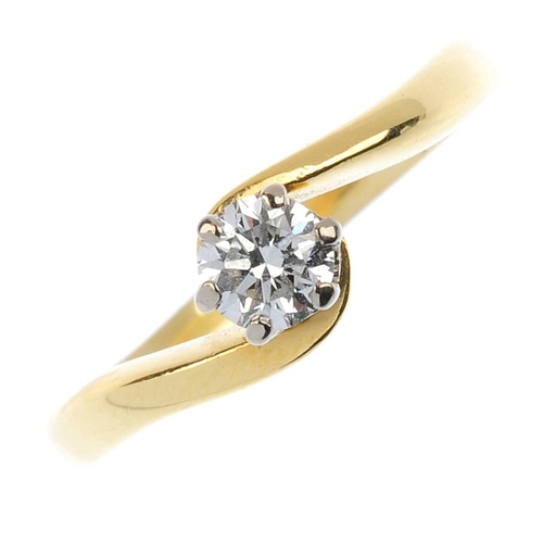 772 - An 18ct gold diamond single-stone ring. The brilliant-cut diamond, with asymmetric shoulders and pla...