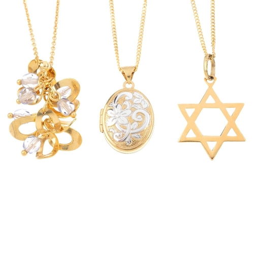773 - Three pendants. To include a 9ct gold oval-shape locket with scroll and floral engraving, a 'Star of...