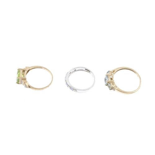 774 - Three 9ct gold diamond and gem-set rings. To include a peridot and diamond ring, a blue topaz and di...
