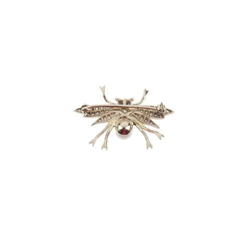 776 - A cultured pearl and diamond bug brooch. Designed as a brilliant-cut diamond body, cultured pearl th...
