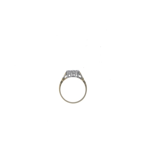 777 - A mid 20th century 18ct gold diamond three-stone ring. The graduated brilliant-cut diamond line, wit...